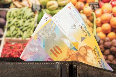 Purse, Swiss francs and food Reklamní fotografie