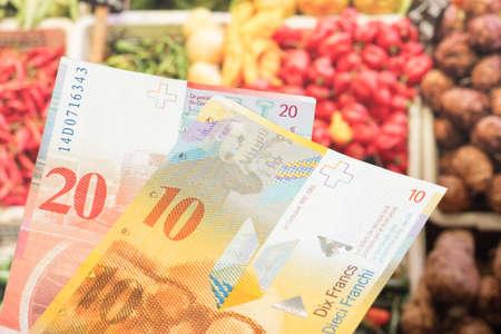 Banknotes Swiss francs and food Reklamní fotografie