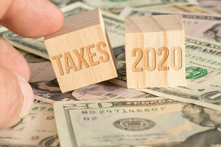 Dollar bills and taxes in 2020 in America
