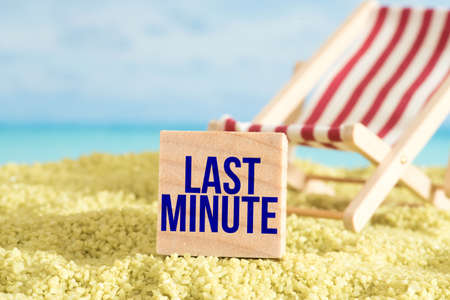 Beach, sunbed and last minute vacation