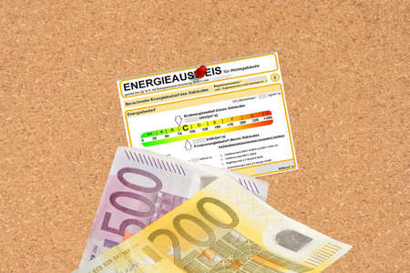 An energy certificate and euro banknotes Stock Photo