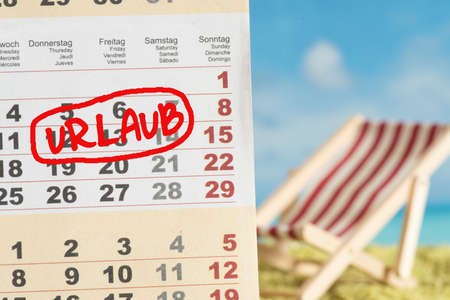 Beach and calendar with reference to vacation Banco de Imagens