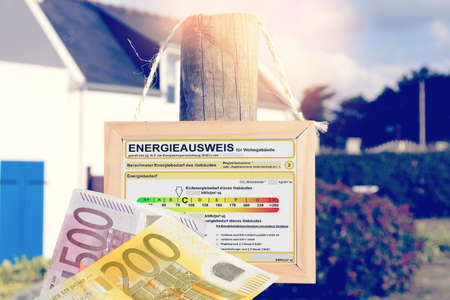 A house, energy pass for a house and euro bills
