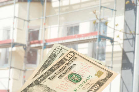 A construction site and dollar bills
