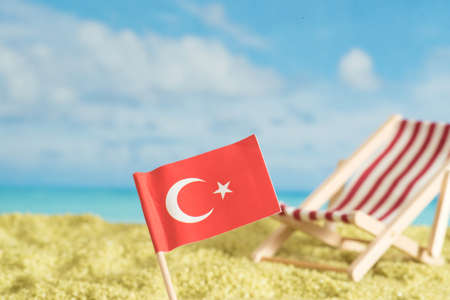 Turkish flag, beach and vacation in Turkey
