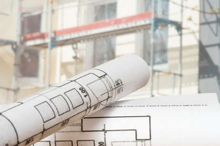Blueprint and a construction site for a house Stock fotó