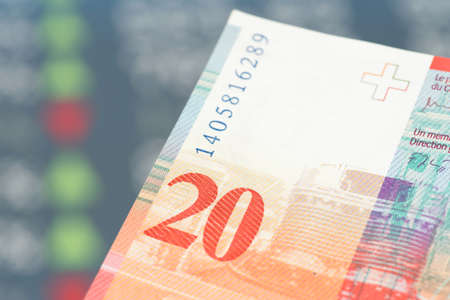 Swiss franc banknote and price list on the stock exchange