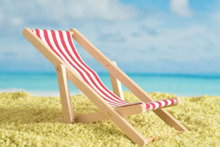 Sunbed, beach and holiday by the sea Standard-Bild