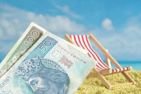 Banknote Polish zloty, beach and holiday Reklamní fotografie