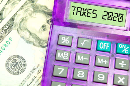 Dollars money, calculator and taxes 2020 in America