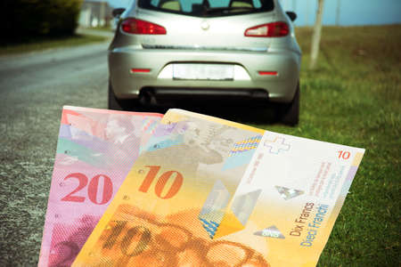 A car and Swiss francs