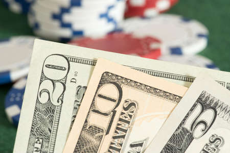 Dollar bills, and tokens in a casino