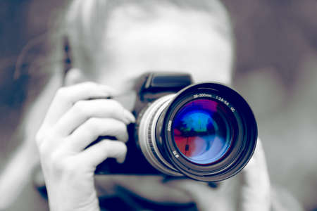 A woman with a camera Imagens