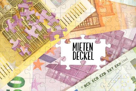 Puzzle aus Euro-Banknoten und der gemieteten Hülle Standard-Bild