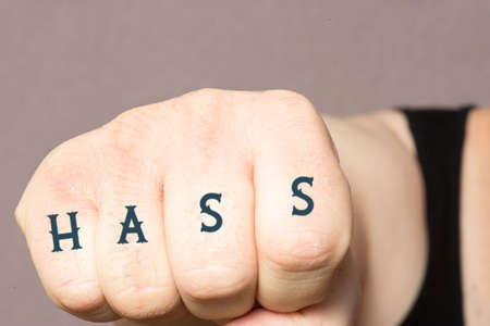 A fist with the word hate