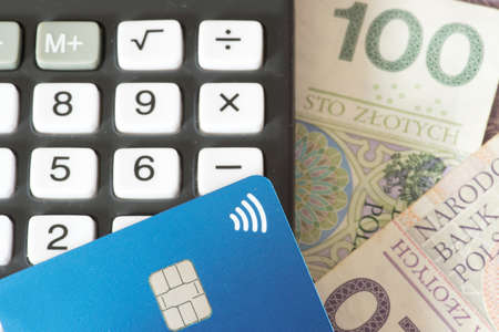 Calculator, credit card and banknotes Polish zloty PLN