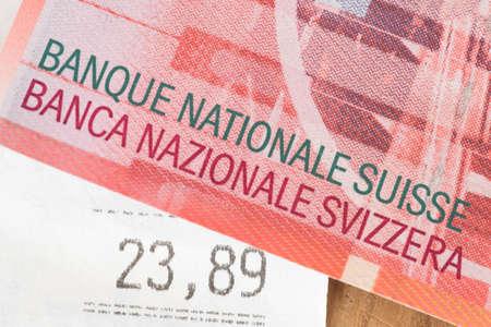 Money Swiss franc and a receipt