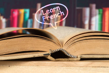 A book and slogan Learn French