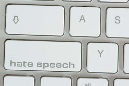 A computer and key for hate speech Stock fotó