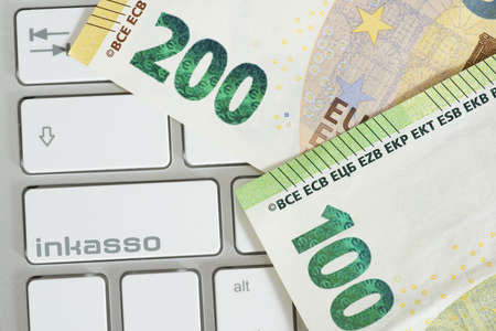 Computer, euro money and key for debt collection