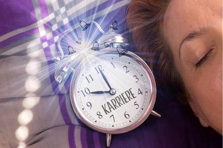 A sleeping woman and alarm clock career Standard-Bild