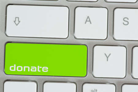 A computer and button for donations
