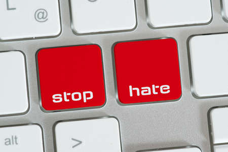 A computer and buttons for stop hate