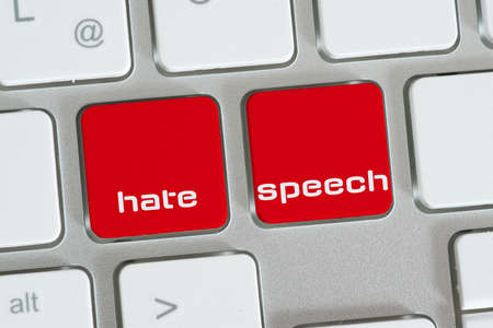 Computer and buttons for hate speech Stock fotó