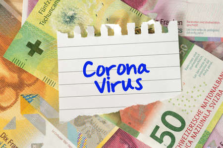 Money Swiss Francs and Corona Virus 版權商用圖片