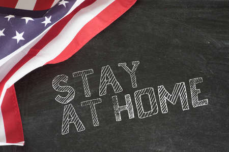 Flag of America and slogan Stay at Home Stok Fotoğraf