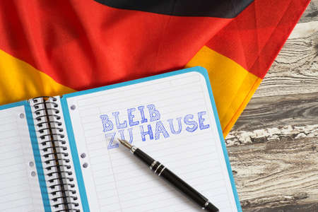 Flag of Germany and slogan stay at home Standard-Bild