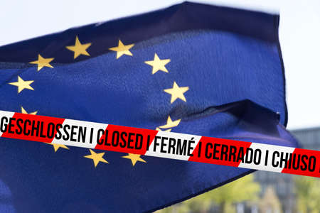 European Union flag EU and barrier tape with the note Closed