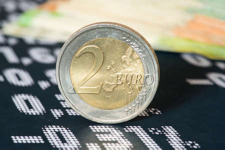 Euro banknotes and coins, course board and the stock exchange 版權商用圖片