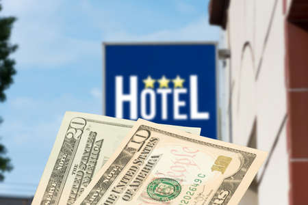 A hotel and dollar banknotes