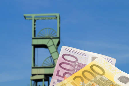 Mine and euro banknotes