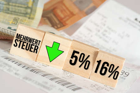 Euro banknotes, sales receipt and VAT reduction