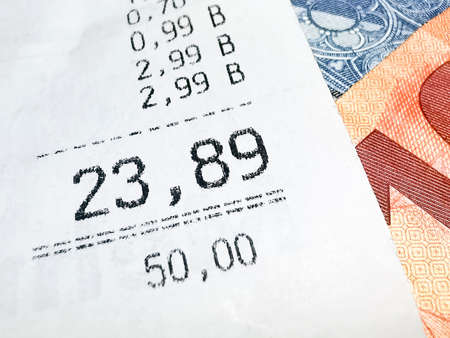 Receipt and euro banknotes