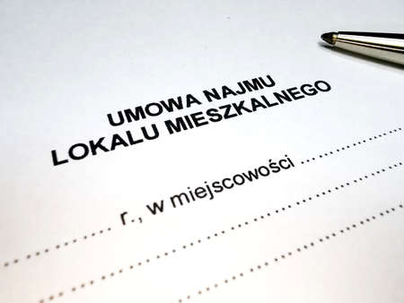 Pen and rental contract in Polish