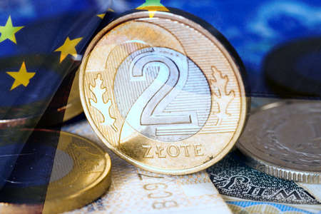 Polish zloty PLN coin and European Union flag