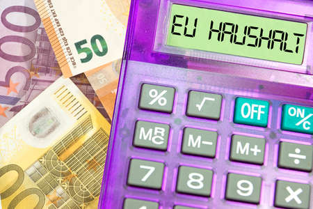 Calculator, euro banknotes and European Union budget