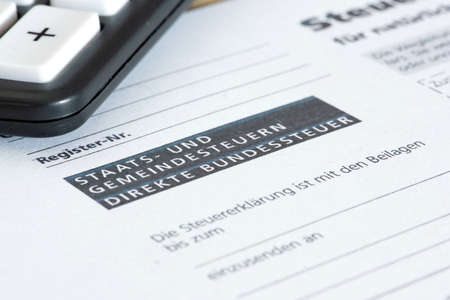Swiss tax return form and a calculator