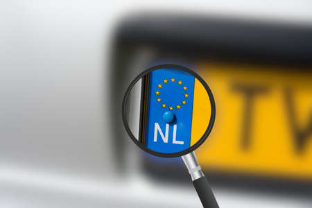 License plate Netherlands and a magnifying glass Stockfoto