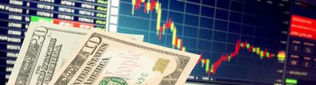 Dollar bills and stock market in America Stock Photo