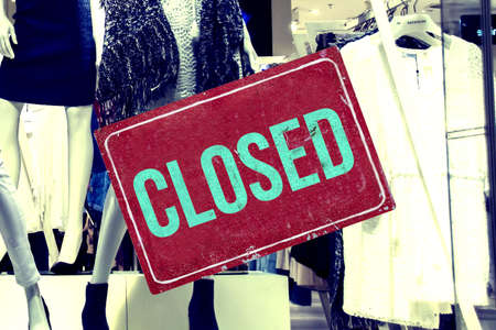 Shop window of a shop and sign closed