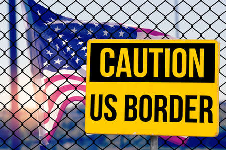 A fence, flag of USA and American border