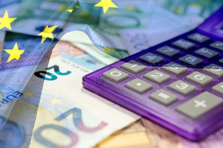 European Union flag, calculator and euro money