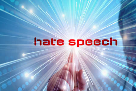A man presses the hate speech button