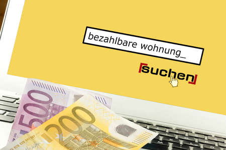 Euro bills, computers and looking for affordable housing