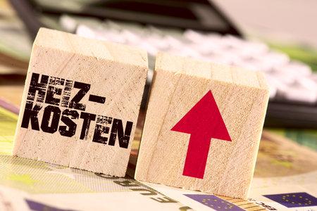 Euro bills, calculators and rising heating costs