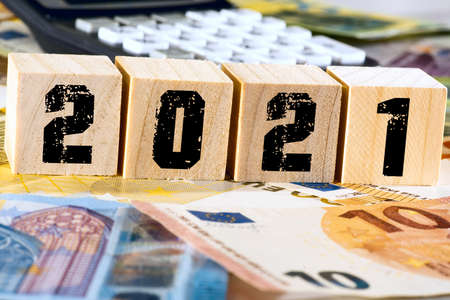 Calculator, euro banknotes and the year 2021